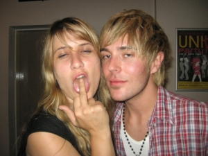 Two Aussies bitches. The gay male is cool as hell. But the drunk blond is one smelly bitch with a taste in music as bad as her stench.
